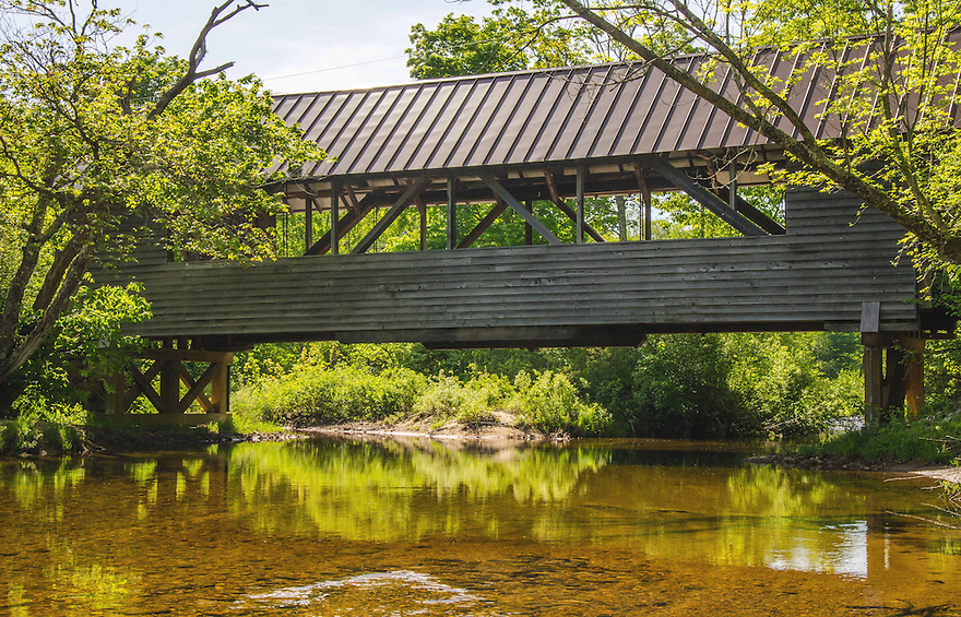 The Bump Covered Bridge spans the Beebe River in the quiet, rural town of Campton.