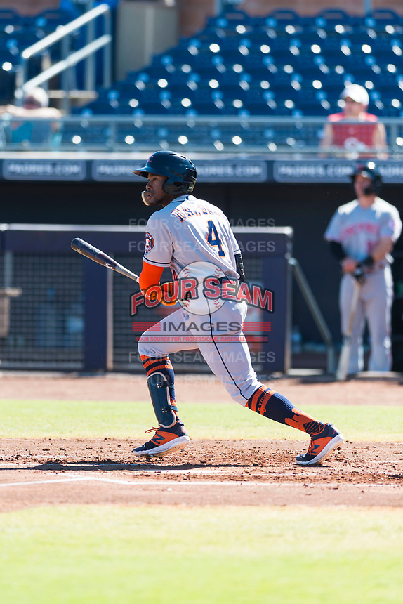 Scottsdale Scorpions center fielder Ronnie Dawson (4), of the Houston Astros organization, follows through on his swing during an Arizona Fall League game against the Peoria Javelinas at Peoria Sports Complex on October 18, 2018 in Peoria, Arizona. Scottsdale defeated Peoria 8-0. (Zachary Lucy/Four Seam Images)