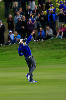 Ian Poulter (EUR) throws a golf ball to the crowd during the Sunday Singles Matches of the Ryder Cup at Gleneagles Golf Club on Sunday 28th September 2014.<br /> Picture:  Thos Caffrey / www.golffile.ie
