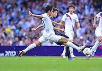 August 10, 2012..South Korea's Park Chu-young and Japan's Takahiro Ohgihara in action during bronze medal match at the Millennium Stadium on day fourteen in Cardiff, England. Korea defeat Japan 2-0 to win Olympic bronze medal in men's soccer. ..