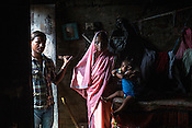 21 year old Seema Devi poses with her husband Vinay Paswan (22) and their 9 month old daughter, Vaishnavi Kumari in the small room of their hut in Shivpur Hariyya village in Raxaul district of Bihar.