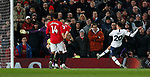Tottenham Hotspur's Dele Alli (R) scores during the Premier League match at Old Trafford, Manchester. Picture date: 4th December 2019. Picture credit should read: Darren Staples/Sportimage