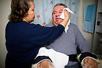 In Home Supportive Services (IHSS) caregiver Teresita Perez de Godoy, left, washes the face of quadriplegic Francisco Godoy in his Sacramento, CA home January 22, 2010. Francisco needs around-the-clock care from Teresita, his ex-wife who also lives with him. The state pays Teresita for 283 hours per month, at $10.40/hour. Gov. Schwarzenegger has proposed cutting or eliminating the IHSS program which provides care for 450,000 Californians and jobs for 375,000 caregivers. If the program was eliminated, most would need to be institutionalized, likely at far greater taxpayer expense. CREDIT: Max Whittaker for The Wall Street Journal.CABUDGET
