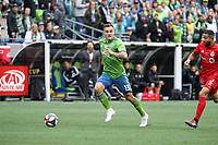 SEATTLE, WA - NOVEMBER 10: Jordan Morris #13 of the Seattle Sounders FC races forward with the ball during a game between Toronto FC and Seattle Sounders FC at CenturyLink Field on November 10, 2019 in Seattle, Washington.