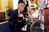 Following the recording of his weekly radio address to the nation from the Oval Office of the White House in Washington, DC, United States President Bill Clinton meets with eight-year-old Christopher Fina of Pennsylvania on Friday, May 26, 1997.  Christopher, who attended the radio address with his family, suffers from congenital muscular dystrophy.<br /> Mandatory Credit: Barbara Kinney / White House via CNP