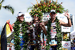 KAILUA-KONA, HI - OCTOBER 13:  (L-R) Andreas Raelert of Germany (2nd),   Pete Jacobs of Australia (1st) and Frederick Van Lierde of Belgium(3rd) pose at the finish line during the 2012 IRONMAN World Championships on October 13, 2012 in Kailua-Kona, Hawaii. (Photo by Donald Miralle)