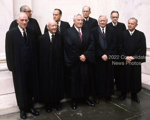 """The 9 Justices of the United States Supreme Court posed for their official """"family """" group photo at the U.S. Supreme Court in Washington, D.C. on Friday, October 9, 1970. Front row, left to right: Associate Justice John Marshall Harlan; Associate Justice Hugo L. Black; Chief Justice of the United States Warren E. Burger; Associate Justice William O. Douglas; and Associate Justice William J. Brennan, Jr.  Back row, left to right: Associate Justice Thurgood Marshall; Associate Potter Stewart; Associate Justice Byron R. White; and Associate Justice Harry A. Blackmun..Credit: Benjamin E. """"Gene"""" Forte / CNP"""