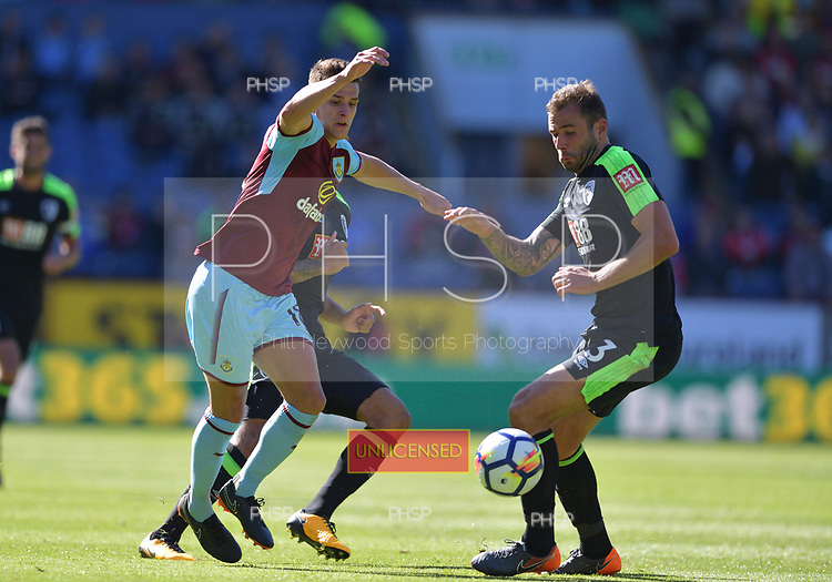 13/05/2018 Premier League Burnley v AFC Bournemouth<br /> <br /> Ashley Westwood battles for possession