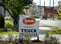 NWA Democrat-Gazette/BEN GOFF &bull; @NWABENGOFF<br /> A sign marks the E. Walnut St. truck entrance on Friday Aug. 7, 2015 at the Tyson Foods facility in downtown Rogers.