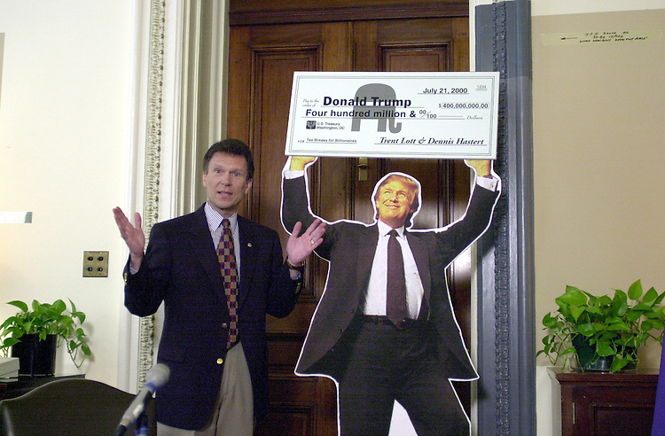 Daschle T.3(DG)072100 -- Tom Daschle, D-S.D., and a cutout of Donald Trump as a prop on the estate tax during his dugout.