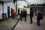 Spectators queueing for refreshments at a snack bar at Victory Park, before Chorley played Altrincham in a Vanarama National League North fixture. Chorley were founded in 1883 and moved into their present ground in 1920. The match was won by the home team by 2-0, watched by an above-average attendance of 1127.