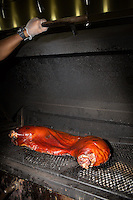 DURHAM, N.C. Tuesday August 5, 2014 - Half a hog smokes at The Pit Authentic Barbecue in Durham, N.C. (Justin Cook for The New York Times)