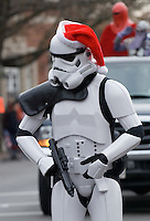 A Start Wars Storm Tropper bears arms and wears a red stocking cap during the Christmas parade in Westerville, Ohio, Sunday, Dec. 3, 2006.<br />