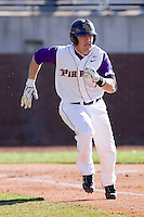 Dustin Harrington #7 of the East Carolina Pirates hustles down the first base line versus the Virginia Cavaliers at Clark-LeClair Stadium on February 19, 2010 in Greenville, North Carolina.   Photo by Brian Westerholt / Four Seam Images