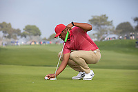 25th January 2020, Torrey Pines, La Jolla, San Diego, CA USA;  Tony Finau places his ball on the green during round 3 of the Farmers Insurance Open at Torrey Pines Golf Club on January 25, 2020