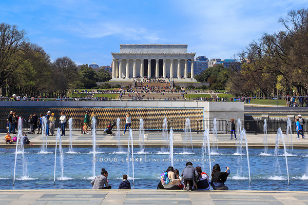 The Lincoln Memorial as seen from a fountain at the WWII Memorial on a sunny spring day in Washington DC, USA