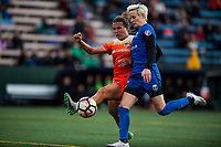 Seattle, WA - Saturday April 22, 2017: Amber Brooks and Megan Rapinoe during a regular season National Women's Soccer League (NWSL) match between the Seattle Reign FC and the Houston Dash at Memorial Stadium.