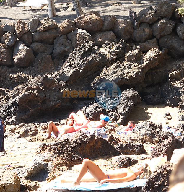 David Cameron MP Prime Minister of the United Kingdom enjoying a swim and the view while on holiday on the Spanish Island of Lanzarote.<br /> Picture: www.newsfile.ie