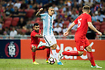 Leandro Paredes of Argentina (R) fights for the ball with Faritz Hameed of Singapore (L) during the International Test match between Argentina and Singapore at National Stadium on June 13, 2017 in Singapore. Photo by Marcio Rodrigo Machado / Power Sport Images