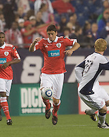 SL Benfica midfielder Filipe Menezes (24) traps the ball. SL Benfica  defeated New England Revolution, 4-0, at Gillette Stadium on May 19, 2010.