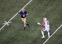Jake Browning fires a pass in the first quarter.