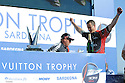 Louis Vuitton Trophy La Maddalena 6 giugno 2010. Un momento della prima e festosa parte della premiazione che si è tenuta sul palco allestito in un piazzale dell'ex arsenale. Grant Dalton uomo chiave dell'equipaggio kiwi inonda di champagne uno dei suoi compagni che volentieri si sottopone alla costosa doccia