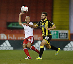 Alex Baptiste of Sheffield Utd and Mason Bennett of Burton Albion - English League One - Sheffield Utd vs Burton Albion - Bramall Lane Stadium - Sheffield - England - 1st March 2016 - Pic Simon Bellis/Sportimage