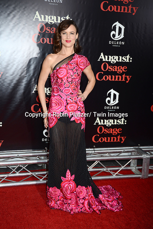 "Juliette Lewis in Naaen Khan pink flowered embroidered dress attends the New York Premiere of ""August: Osage County"" on December 12, 2013 at the Ziegfeld Theatre in New York City."