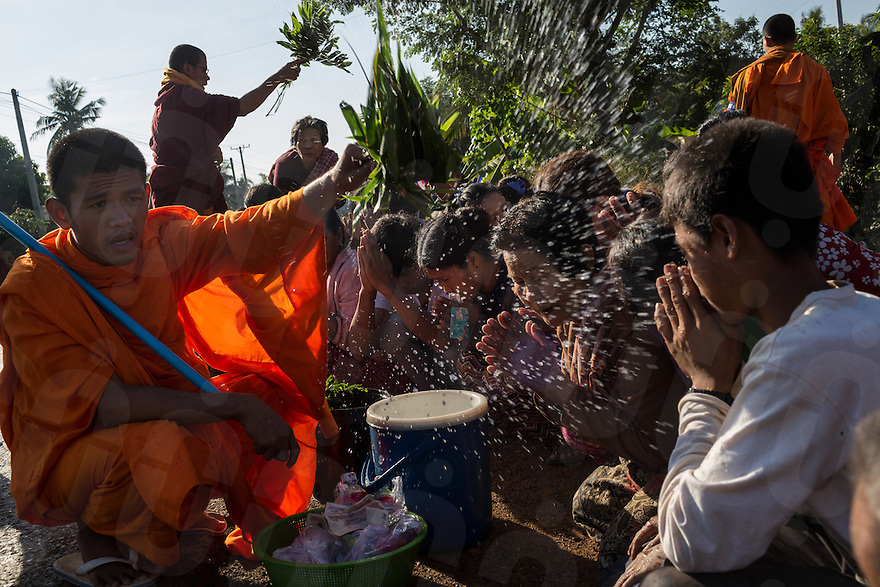 December 04, 2013 - Kampong Thom, Cambodia. Monks hold a blessing on the road during a 10 day Human Rights march through the country. © Nicolas Axelrod / Ruom