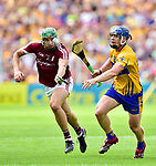 Adrian Tuohey of Galway in action against Podge Collins of Clare during their All-Ireland semi-final replay at Semple Stadium,Thurles. Photograph by John Kelly.