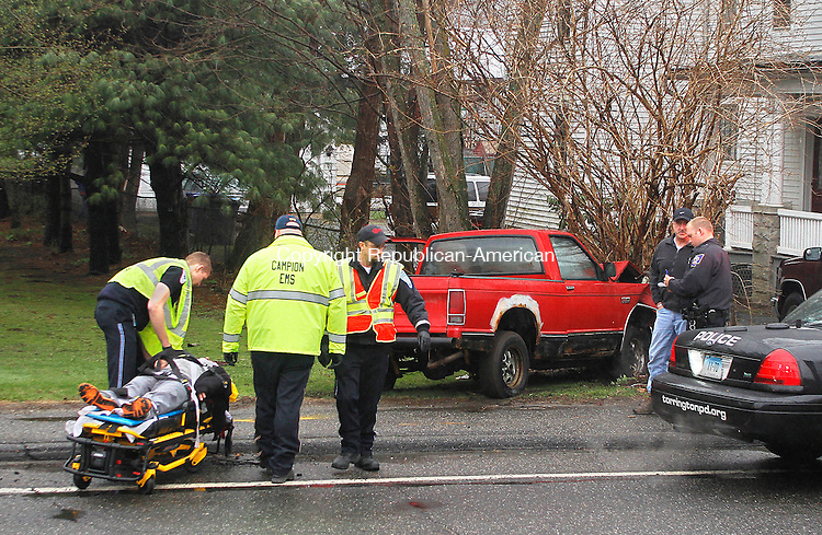 TORRINGTON, CT.- 26 APRIL 2014 - 042614JW03 - The driver of a pickup involved in a one vehicle accident is helped by EMTs as Torrington Fire and Police officials investigate the accident on South Main Street Saturday morning.<br /> Jonathan Wilcox Republican-American