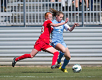 Kealia Ohai (7) of North Carolina fights for the ball with Tori Huster (23) of the Washington Spirit during the game at the Maryland SportsPlex in Boyds, MD.  The Washington Spirit defeated the North Carolina Tar Heels in a preseason exhibition, 2-0.
