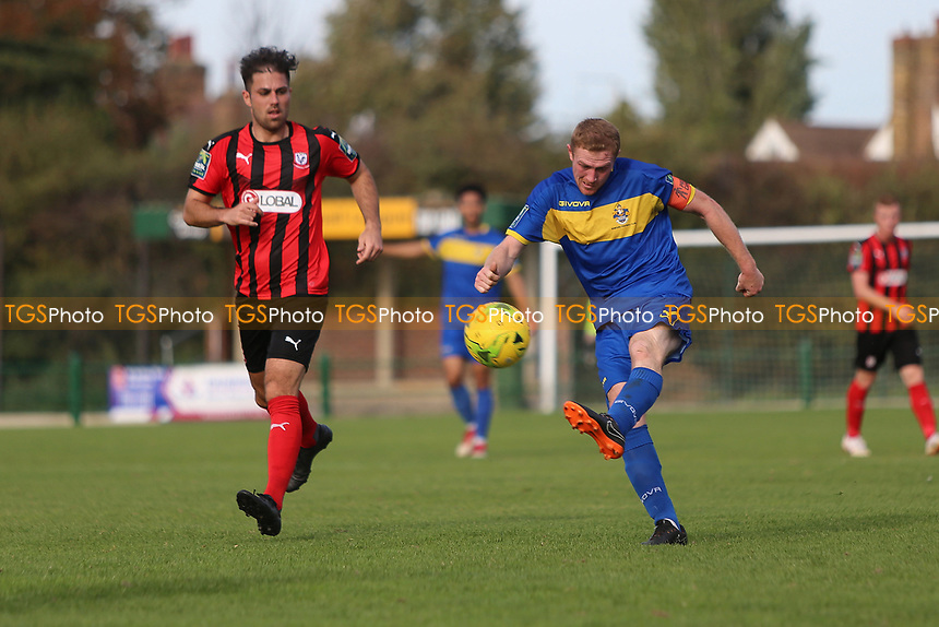 Danny Cossington of Romford clears during Romford vs Coggeshall Town, Bostik League Division 1 North Football at Rookery Hill on 13th October 2018