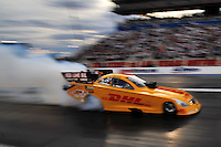 Oct. 31, 2008; Las Vegas, NV, USA: NHRA funny car driver Jeff Arend does a burnout during qualifying for the Las Vegas Nationals at The Strip in Las Vegas. Mandatory Credit: Mark J. Rebilas-
