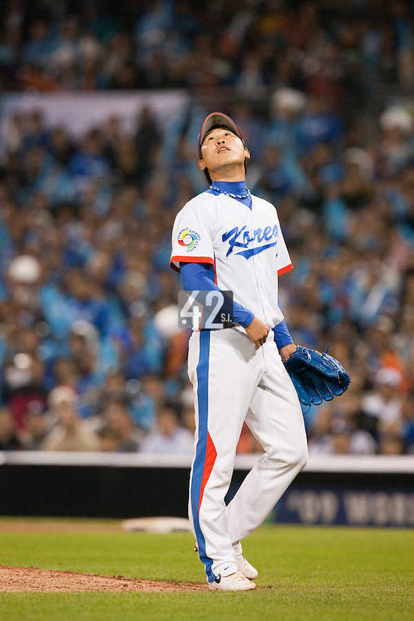 17 March 2009: #28 Suk Min Yook of Korea watches a fly ball as he pitches against Japan during the 2009 World Baseball Classic Pool 1 game 4 at Petco Park in San Diego, California, USA. Korea wins 4-1 over Japan.