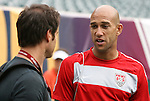 28 May 2010: Tim Howard (right) talks with broadcaster John Harkes (left). The United States Men's National Team held a practice session at Lincoln Financial Field in Philadelphia, Pennsylvania the day before playing Turkey in their final home friendly prior to the 2010 FIFA World Cup in South Africa.