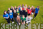 Marcus Howlett (front Centre), Teachers Anna De Staic, Allan O'Connor and Students of Presentation Tralee and Gaelcholáiste Chiarraí launch the Easter 5K for Children at a training session at the Tralee Harriers Ground on Tuesday