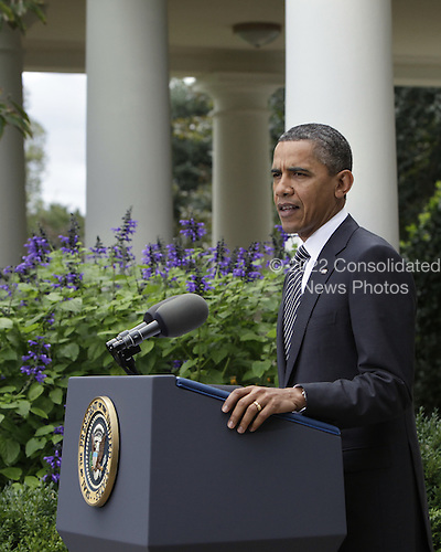 United States President Barack Obama makes a statement in the Rose Garden of the White House in Washington, D.C. following the government of Libya's announcement of the death of former dictator Colonel Muammar Qaddafi..Credit: Yuri Gripas / Pool via CNP