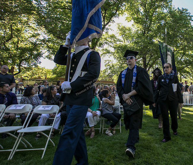 Student body president Brandon Boone leads graduates onto the quad during the University of Nevada College of Agriculture, Biotechnology & Natural Resources and College of Education graduation ceremony on Friday evening, May 19, 2017.