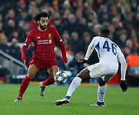 5th November 2019; Anfield, Liverpool, Merseyside, England; UEFA Champions League Football, Liverpool versus Genk; Mohammed Salah of Liverpool takes on Carlos Cuesta of KRC Genk - Editorial Use