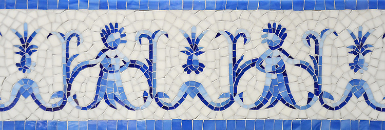 """Pineapple People, a hand-nipped 8 1/4"""" mosaic border shown in Lapis Lazuli, Iolite, and Covelite with an Absolute White Sea Glass™ background, is part of the Sea Glass™ Collection by New Ravenna."""