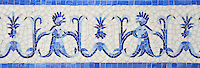Pineapple People, a hand-nipped jewel glass 8 1/4&quot; mosaic border shown in, Lapis Lazuli, Iolite and Covelite with an Absolute White Sea Glass&trade; background, is part of the Delft Collection by Sara Baldwin for New Ravenna.<br />