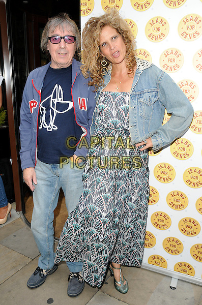 BILL & SUZANNE WYMAN.at the Genes for Jeans Celebri-Tee party Sanctum Soho, London, England, UK,.June 22nd 2010..celebrity tea full length married couple husband wife long maxi dress print denim jacket blue hoodie sunglasses hand on hip grey gray.CAP/CAN.©Can Nguyen/Capital Pictures.