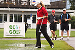 Taylor Leon from Dallas, Texas walks over a small puddle before getting to the 10th tee at Alliance Bank Golf Classic in Syrcause, NY.
