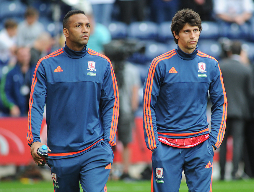 Middlesbrough's Emilio Nsue (left) and Diego Fabbrini walk out ahead of kick-off<br /> <br /> Photographer Kevin Barnes/CameraSport<br /> <br /> Football - The Football League Sky Bet Championship - Preston North End v Middlesbrough -  Sunday 9th August 2015 - Deepdale - Preston<br /> <br /> &copy; CameraSport - 43 Linden Ave. Countesthorpe. Leicester. England. LE8 5PG - Tel: +44 (0) 116 277 4147 - admin@camerasport.com - www.camerasport.com