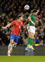 5th March 2014; Shane Long, Ireland, in action against Branislav Ivanovic, Serbia. International Friendly, Republic of Ireland v Serbia, Aviva Stadium, Dublin. Picture credit: Tommy Grealy / actionshots.ie