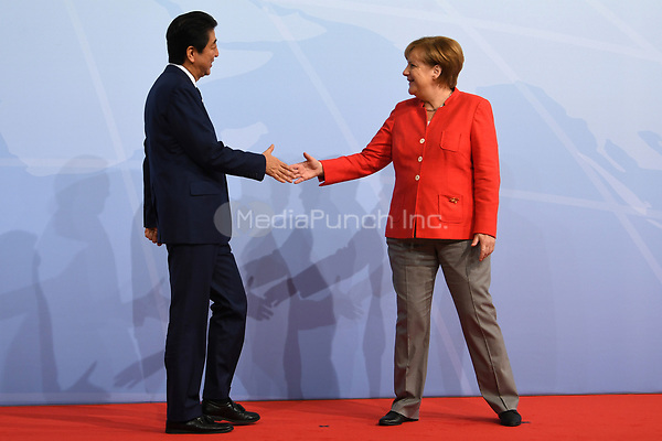 German chancellor Angela Merkel greets the Japanese prime minister Shinzo Abe at the G20 summit in Hamburg, Germany, 7 July 2017. The heads of the governments of the G20 group of countries are meeting in Hamburg on the 7-8 July 2017. Photo: Bernd Von Jutrczenka/dpa-pool/dpa /MediaPunch ***FOR USA ONLY***