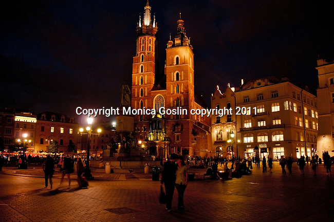 St. Mary's Basilica in Krakow, Poland at night. St. Mary's Basilica sits on the Main Market Square, and was first built in the 13th century