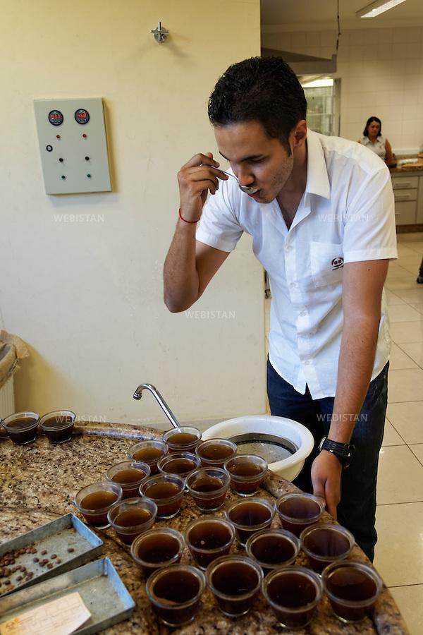 Bresil, etat Minas Gerais, Guaxupe, Cooxupe, 31 octobre 2012.<br /> <br /> Cooxupe est l&rsquo;une des plus grosses cooperatives bresiliennes de cafe. Elle a signe un partenariat avec Nespresso dans le cadre du Programme AAA. Elle dispose de plusieurs sites dont celui de Guaxupe qui s'est dote, en 2008, d'un laboratoire ultra-moderne d'analyse du cafe. <br /> Dans le  laboratoire  d'analyse du cafe ultra-moderne, Silvio Mussarra goute les differents jus disposes  sur la table de tests.<br /> Reportage les Chants de cafe_soul of coffee, realise sur les acteurs terrain du programme de developpement durable Triple AAA de Nespresso.<br /> <br /> Brazil, Minas Gerais, Guaxupe, Cooxupe, October 31, 2012 <br /> <br /> Cooxupe, one of the largest coffee cooperatives in Brazil, signed a partnership with Nespresso AAA Program. Cooxupe has several sites, including one in Guaxupe, which in 2008 acquired a state-of-the-art laboratory to analyze coffee. <br /> In the state-of-the-art laboratory to analyze coffee, Silvio Mussarra tastes the different flavored coffees that are on the testing table. <br /> Assignment: les Chants de cafe_ Soul of Coffee, implemented on the fields of Nespresso&rsquo;s AAA Sustainable Quality Program.
