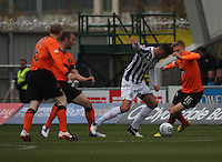 Steven Thompson (centre) challenged by Stuart Armstrong in the St Mirren v Dundee United Clydesdale Bank Scottish Premier League match played at St Mirren Park, Paisley on 27.10.12.
